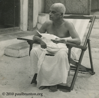 Krishna_Menon_sitting_in_chair_with_copyright