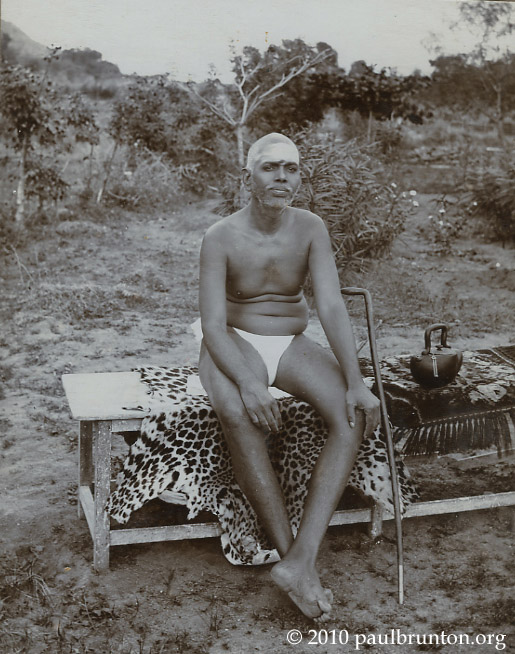 Ramana_sitting_on_bench_with_copyright